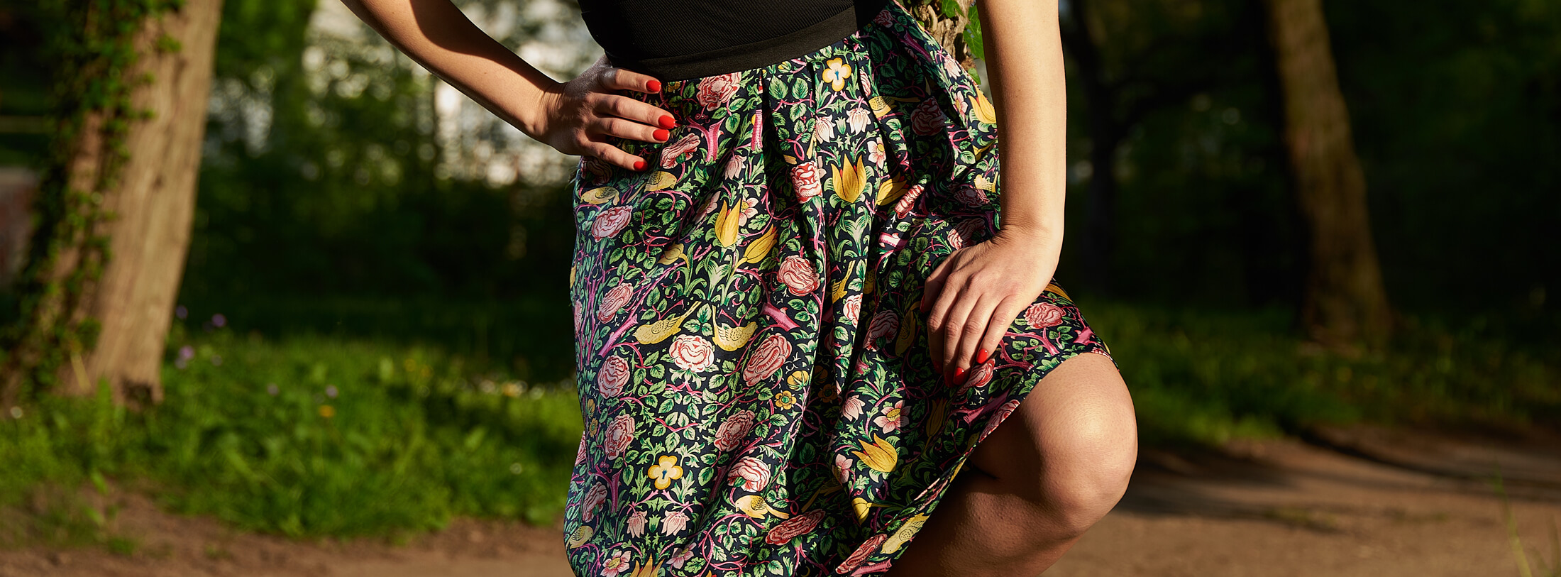 Wearing Amélie, pleated silk twill skirt with floral print in the park