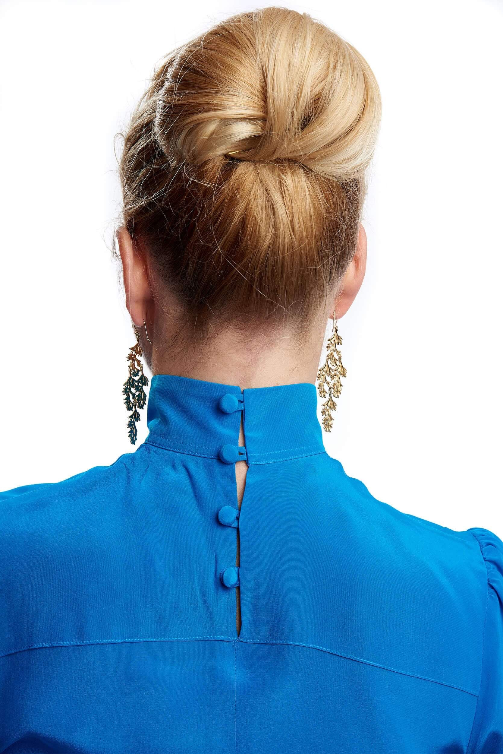 silk buttons of marie blouse and elegant bun